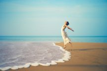 Massage Therapy energized woman at the water's edge